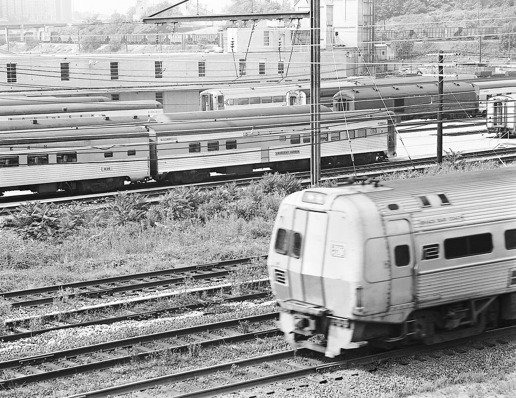Amtrak southbound Metroliner operating on the electrified Northeast Corridor is seen blasting past a passenger car service area in the Ivey City Railroad Yard at Washington, D.C., June 1976