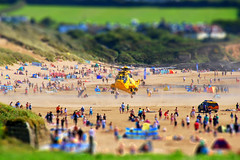 Emergency Landing (Anna_Shirley) Tags: summer people rescue holiday beach toy miniature sand nikon crowd shift landing helicopter gathering practice emergency tilt propeller blades 999 d60 tiltshift windbreak tiltshiftmaker