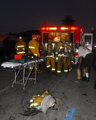 Two Firefighters Injured Battling South Los Angeles Blaze. © Photo by Chris Conkle, click to see more...