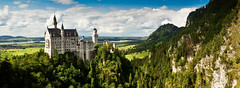 Neuschwanstein Panorama (paulwynn-mackenzie.co.uk) Tags: blue trees summer panorama house holiday mountains green slr castle clouds photoshop germany landscape bavaria photography scenery warm postcard sony a33 adobe neuschwanstein ludwig slt pp lightroom postprocessing madludwig cs5 slta33
