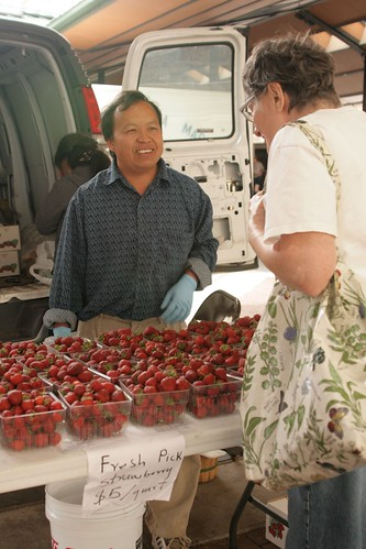 """NIFA's Beginning Farmer and Rancher Development Program funds projects to help train individuals in areas like agribusiness. Here, a program participant sells his goods at a farmer's market in Minnesota. "" (Photo credit: Hli Xyooj)"