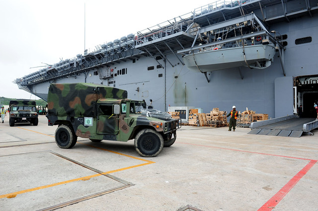 High mobility multi-purpose vehicles with the 31st MEU drive onto the USS Essex (LHD 2) at White Beach Naval Facility Okinawa