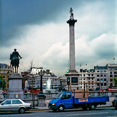 f.AJ-11 Trafalgar Square (listentoreason) Tags: uk england sky london clouds nikon europe minolta unitedkingdom britain scanner scenic trafalgarsquare eu places scanned coolscan europeanunion asa400 greatbritian 5000ed coolscan5000ed score20 freedom50 minoltafreedom50
