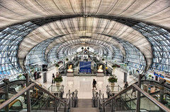 Suvarnabhumi's Spine (Dan Chui (on/off!)) Tags: city travel urban motion glass metal architecture modern buildings geotagged thailand design airport nikon asia adobephotoshop bangkok interior aviation airplanes transport landmark terminal tourists symmetry busy handheld 24mm metropolitan hdr topaz    noiseware photomatix  suvarnabhumiairport niksoftware d700