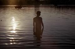 ef_057 (mariczka) Tags: sunset lake reflection slr film water backlight analog 50mm boat back waves f14 fujicolorsuperia200 vintageanalogue iliapavlov lubotyn