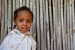 portrait of a little girl outside the church of Debre Sina Gorgora to the north shore of Lake Tana, northern Ethiopia (anthony pappone photography) Tags: africa travel portrait baby barn digital canon pose children photography photo child faces image expression retrato african picture culture monastery portraiture childrens afrika enfants fotografia ethiopia ethnic orthodox bahirdar ritratto afrique barna eastafrica phototravel etiopia etnic gondar 非洲 etnico ethiopie etiope etnia laketana アフリカ etnica etnologia afryka childrentravel etiopija portraitsofchildren 아프리카 éthiopie etiopien etiópia африка ethnc etiopi eos5dmarkii अफ्रीका childrenbestphotos