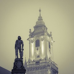 The Knight in the Fog (Gilderic Photography) Tags: city trip travel winter shadow vacation sky urban sculpture mist holiday cold art history clock church strange rain statue fog stone architecture canon square eos europe raw december pierre hiver culture pluie ciel knight slovensko slovakia chevalier armour bratislava brouillard eglise brume lightroom armure carre 500d 500x500 slovaquie gilderic bichro