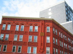 NYC 2011 242 (catchesthelight) Tags: nyc urban building modern brooklyn details arches queens astoria traveling greenpoint longislandcity redbrick oldnew outthecarwindow intraffic turnofthecentury nyscene apnewspaperstory
