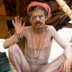 Hello! (Dick Verton) Tags: travel people india sitting sit varanasi seated sadhu ganges ghats