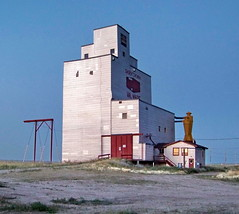 SKSW11g9X Val Marie Grain Elevator, Saskatchewan (CanadaGood) Tags: morning blue red white canada color colour building dawn sk prairie saskatchewan agriculture grainelevator 2011 valmarie canadagood thisdecade