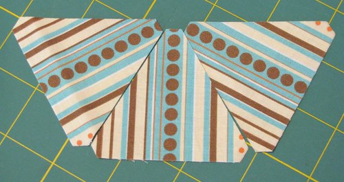 fussy-cutting stripes with AccuQuilt triangle dies