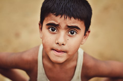 Is that a camera? (A. adnan) Tags: portrait beautiful project kid eyes sand nikon eyecontact colours dof child bokeh f2 bangladesh chittagong nikkor50mmf14d nikon50mmf14d bangladeshiphotographer 100strangers d7000 peopleofbangladesh aadnan613