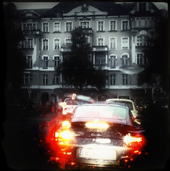 ... (Pez Brige) Tags: light red blackandwhite berlin monochrome rain porsche brake redlight iphone selectivecolor porscheturbo schwarzweis instagram