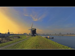 two mills and a boat (Wim Koopman) Tags: light sky holland building mill water windmill dutch yellow canon river photography boat photo stock nederland powershot netherland dyke dike stockphoto s90 stockphotography s100 heusden wpk s95