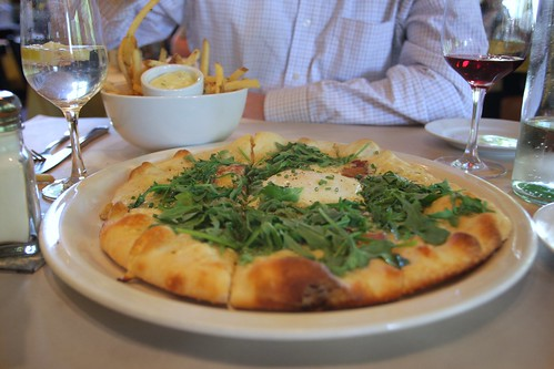 fontina, bacon, arugula pizza with an egg on top