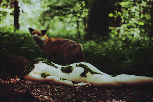 it is the fox who cares about girl's soul. she died in the woods and now her flesh is overgrown by moss. by laura makabresku