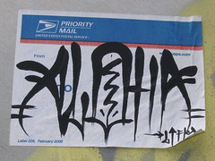 ALOHA (]L ][ /A\ ]M[) Tags: streetart oregon portland graffiti sticker glue illegal slap