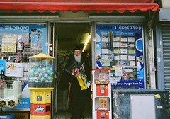 Lottery ticket, flowers and 20 fags, sorted. (deepstoat) Tags: flowers london film 35mm surprise holloway contaxt3 kodakportra400nc newsagents greekorthodoxpriest