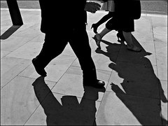 Walking on grey (Alberto Pasini) Tags: street people bw london walking grey shadows streetphotography spnp albertopixel londonstreetphotographyfestival