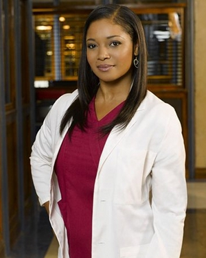 Tamala Jones as Lanie Parish, in a white coat