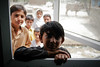 Outside, looking in (Lil [Kristen Elsby]) Tags: asia muzaffargarh punjab southasia unicef floods portrait boy child children boys school temporaryschool education window mullanwalla primaryschool 203528l 2035f28l pakistan topv2222