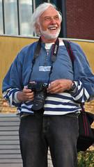 Smiling Sony Photographer (garryknight) Tags: camera man london smile canon fun photographer powershot creativecommons queenswalk lightroom sx220hs