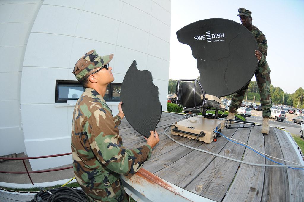 Sailors set up satellite communications equipment during Trident Warrior 2011