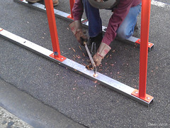 Making the anchor hole larger (Steven Vance) Tags: road street orange wickerpark bike bicycling design wpb bicicleta transportation vlo bikerack ssa roadway dero milwaukeeavenue bikeparking bikecorral wickerparkbucktown onstreetbikeparking ssa33 bikeparkingcorral bikechi wpbrides