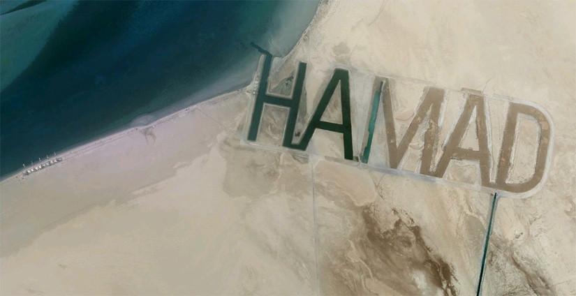 Un nombre en la arena visible desde el espacio