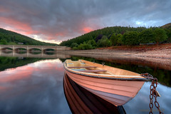 the billows no longer roll (gobayode photography...times) Tags: lake nature reflections boat fishingboat ladybowerreservoir anglersrest naturecolors anchoredboat boatonlake ashoptonbridge derbyshirelandscape anglingboat ladybowerfishingclub chainedboat ashoptonderbyshire fishingonladybower