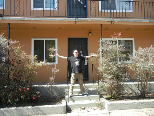 Rik in front of new apartment in Oakland