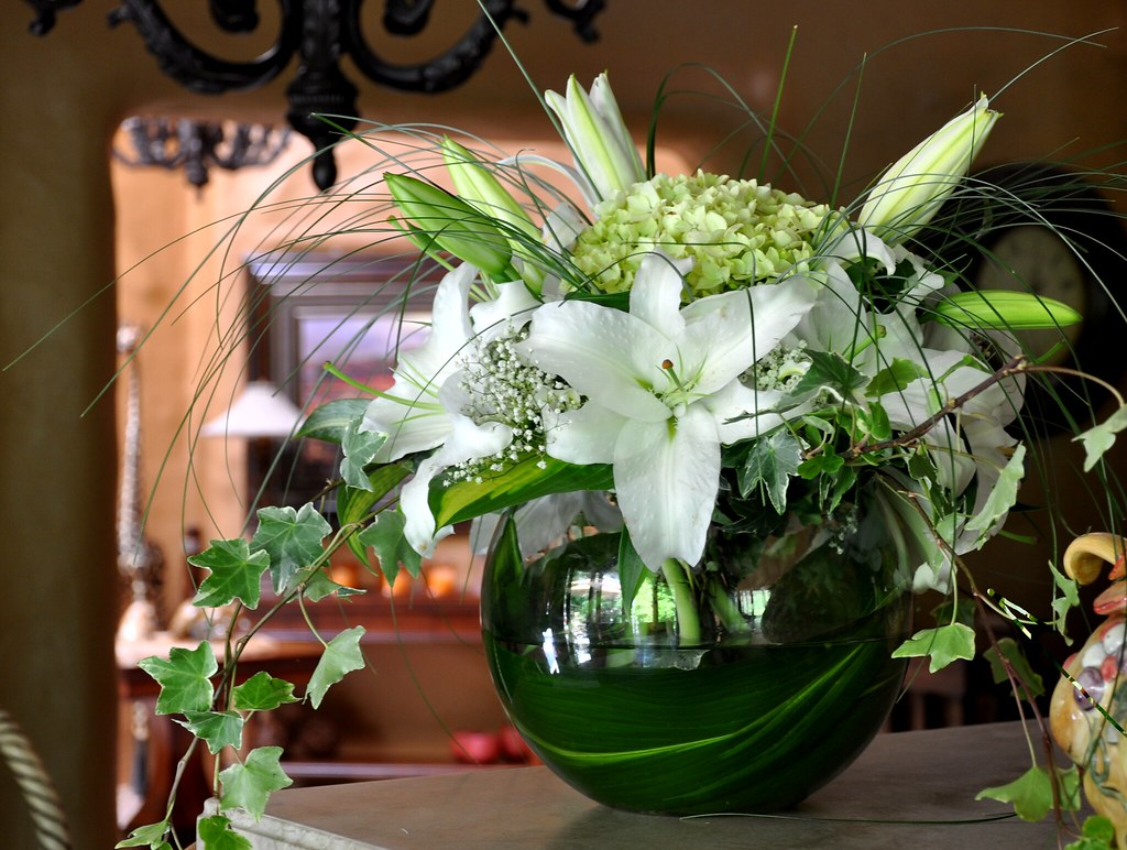 Floral arragement of lilies and hydrangeas in a fish bowl