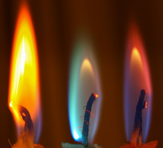 Three different coloured candle lights