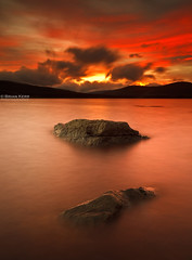 Raining Fire (.Brian Kerr Photography.) Tags: longexposure sunset sky mountains water clouds forest canon landscape scotland rocks scottish loch dumfriesandgalloway newgalloway clatteringshaws gallowayforest eos5dmkii briankerrphotography