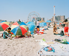 . (Sean Litchfield) Tags: summer newyork mamiya beach brooklyn coneyisland cool colorful ferriswheel umbrellas portra ftrain rz67 seanlitchfield