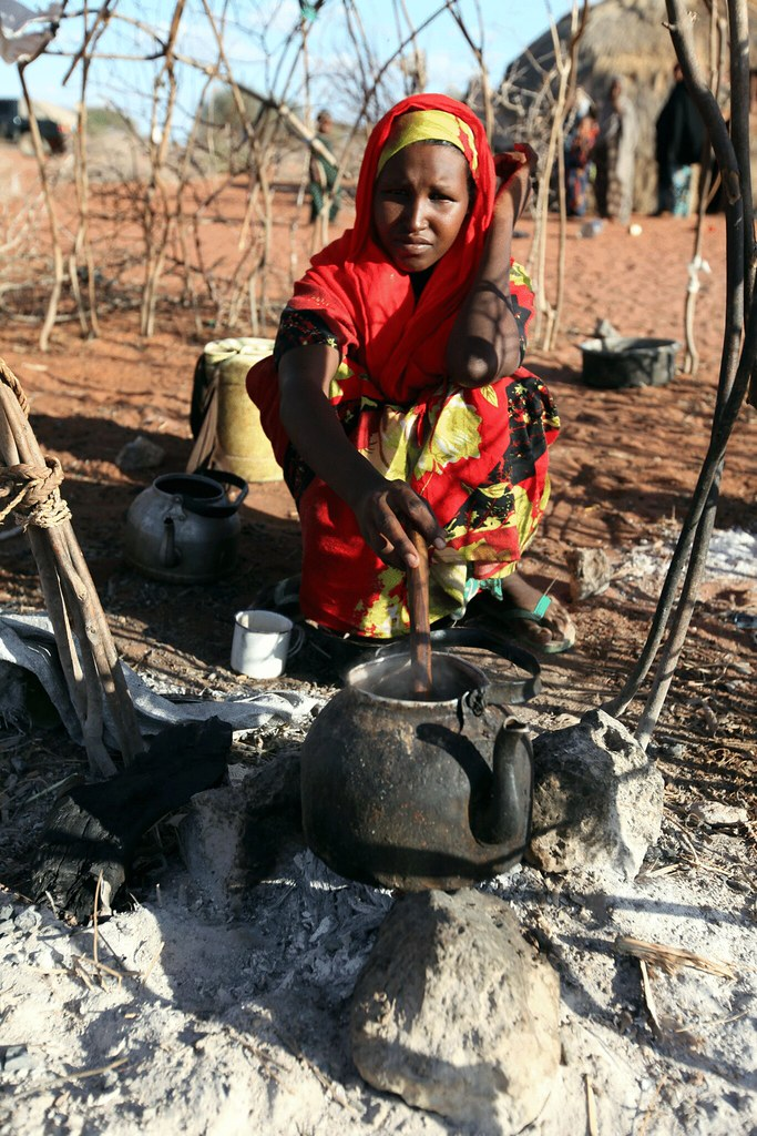 Nouria cooks rice in the kitchen of her home in the village of Abdiaziz, just outside Wajir, Kenya.