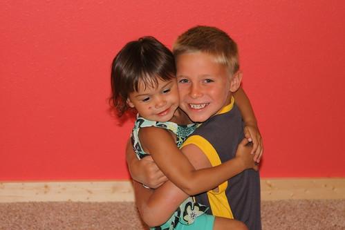 Kaidence hugs Bryce hello