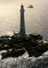 Skerryvore Lighthouse and Pharos (iancowe) Tags: ocean lighthouse tower silhouette rock boat ship view pillar aerial atlantic inner helicopter stevenson tender tiree hebrides pharos northernlighthouseboard nlb skerryvore lighthousetrek alanstevenson wbnawgbsct