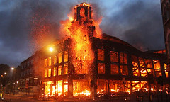 A building set on fire during the Tottenham Rebellion in North London on August 6, 2011. The death of Mark Duggan sparked the unrest that spread rapidly. by Pan-African News Wire File Photos