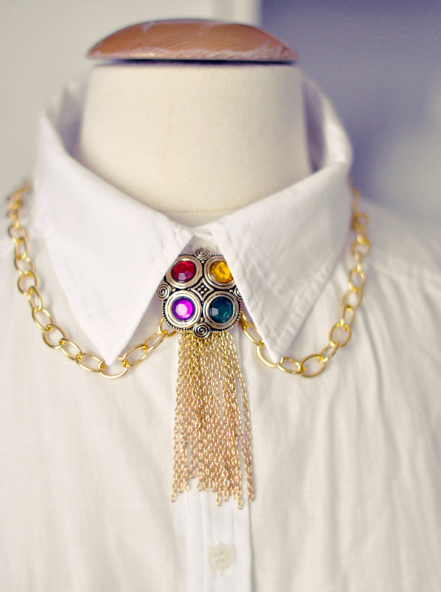 gilded necklace  with  gemstones and gold chains