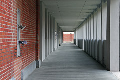 The news (Frankss) Tags: red brown building lines architecture geotagged concrete grey newspaper gallery post mail belgium many gray columns masonry repetition oostende depth modernarchitecture brickwork repeat repetitive