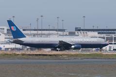 N675UA starts take off roll (SBGrad) Tags: sanfrancisco aperture sfo boeing nikkor 767 unitedairlines ksfo alr staralliance 2011 d90 nikor aerotagged 767322 80200mmf28dafs n675ua aero:series=300 aero:man=boeing aero:model=767 aero:airline=ual aero:special=er aero:airport=ksfo tc20eiii aero:tail=n675ua
