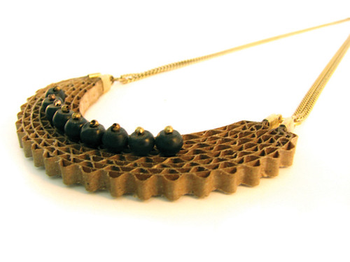 elegant cardboard semi-circle necklace with onyx stones and gold chain