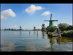 Zaanse Schans Windmills (Kader Lagraa) Tags: wood travel blue light sky color tourism water netherlands beautiful beauty dutch cheese architecture clouds composition contrast buildings landscape photography photo amazing interesting nikon europe village shot image feel windmills mm tradition charming capture making tool learn vr attraction zaanse schans beautifull lense discover sense speciality 28300 kader abdelkader d700 lagraa klagraa