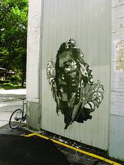 Boy's Dream (cera_mke) Tags: portrait woman streetart green art abandoned girl face graffiti paint fineart bank stamp milwaukee illegal printmaking blockprint cera woodblock mke paintedface woodcutprint largescale downerave