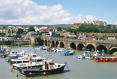 Folkestone (Zanna Allen) Tags: camera old bridge houses light sea cloud colour slr film water clouds boats photography boat town photo md day allen harbour horizon july railway olympus viaduct frame fujifilm disused daytime mm manual 35 zanna om1 folkestone 2011