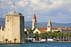 City of Trogir and the Tower of the Kamerlengo Castle (Alex E. Proimos) Tags: city tower castle water palms coast day cloudy flag entrance croatia dalmatian trogir croatian
