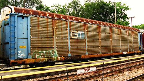 A very rusty former Grand Trunk Western Tri Leval Auto Rack car in transit.  River Grove Illinois USA. Sunday, July 24th, 2011. by Eddie from Chicago