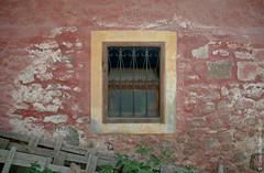 Maybe (Caraballo Reinhardt) Tags: travel red art window beauty stone architecture rural design nikon decoration greece lesvos urbanism decadence molyvos