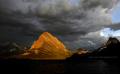 Let there be light (Deby Dixon) Tags: morning light mountain lake snow storm tourism clouds sunrise photography nationalpark travels montana dramatic adventure glaciernationalpark deby allrightsreserved grinnell 2011 manyglacier naturephotographer debydixon debydixonphotography